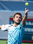 Stanislas Wawrinka (SUI) loses to Julien Benneteau (FRA) at the Western & Southern Open by 16 61 62 in Mason, OH on August 15, 2014.