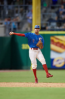 Clearwater Threshers shortstop Arquimedes Gamboa (7) throws to first base during a game against the Tampa Tarpons on July 31, 2018 at Spectrum Field in Clearwater, Florida.  Clearwater defeated Tampa 4-2.  (Mike Janes/Four Seam Images)