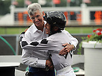 Winning jockey Francisco Torres hugs trainer Danny Miller after winning the Modesty H. Stakes aboard Romantica