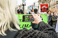 London, England on 15 March 2019: a woman take a photo with his smarphone during the youth climate strike in London. The protest against climate change and urge the government to take action.The global movement has been inspired by teenage activist Greta Thunberg, who has been skipping school every Friday since August to protest outside the Swedish parliament. Photo Adamo Di Loreto/BunaVista*photo
