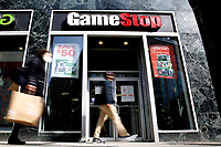 NEW YORK - NEW YORK - MARCH 23: People walk in front of GameStop at 6th Avenue on March 23, 2021 in New York. GameStop stocks falls more than 10% after the video game store showing  strong earnings but lower than expected. (Photo by John Smith/VIEWpress)
