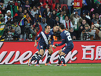 Landon Donovan and teammates celebrate his 48th minute goal to begin the U.S. second-half comeback. The United States came from a 2-0 halftime deficit to Slovenia to earn a 2-2 draw their second match of play in Group C of the 2010 FIFA World Cup.