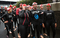 10 AUG 2014 - LIVERPOOL, GBR - Team Liverpool MPs team member Shadow Secretary of State for Health Andy Burnham (centre) talks with other competitors as he walks to the pontoon for the start of the Tri Liverpool triathlon relay in Kings Dock in Liverpool, Great Britain. Burnham finished the swim leg in 20:50, with Steve Rotherham completing the bike in 48:26 and Luciana Berger finishing off with a 35:45 run (PHOTO COPYRIGHT © 2014 NIGEL FARROW, ALL RIGHTS RESERVED)
