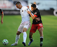 WASHINGTON, DC - MARCH 07: Ben Sweat #22 of Inter Miami CF battles the ball with Edison Flores #10 of D.C. United during a game between Inter Miami CF and D.C. United at Audi Field on March 07, 2020 in Washington, DC.