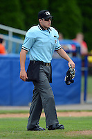 Umpire Brennan Miller during a game between the State College Spikes and Batavia Muckdogs on June 30, 2013 at Dwyer Stadium in Batavia, New York.  State College defeated Batavia 7-2.  (Mike Janes/Four Seam Images)