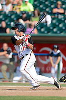 Lansing Lugnuts second baseman Christian Lopes (14) during a game against the Dayton Dragons on August 25, 2013 at Cooley Law School Stadium in Lansing, Michigan.  Dayton defeated Lansing 5-4 in 11 innings.  (Mike Janes/Four Seam Images)