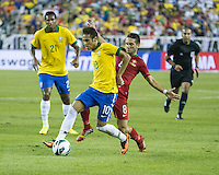 Brazil forward Neymar (10) dribbles the ball as Portugal midfielder Joao Moutinho (8) moves in to tackle.  In an International friendly match Brazil defeated Portugal, 3-1, at Gillette Stadium on Sep 10, 2013.