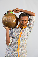 """Bhimashankar Kamble, 45 collects 10 pots of water everyday from public taps in the drought-hit city of Latur. """"I have leave work and come here. It takes me 2-3 hours to fill water. I don't get work because I get delayed, since I'm a day labourer."""""""