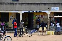 UGANDA, Karamoja, Kotido, Karamojong pastoral tribe, solar panels for power generation and battery recharging