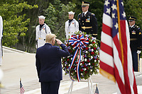 United States President Donald J Trump salutes as he and First lady Melania Trump commemorate Memorial Day by participating in a Wreath Laying ceremony at the Tomb of the Unknown Soldiers at Arlington National Cemetery in Arlington, Virginia on Monday, May 25, 2020.<br /> Credit: Chris Kleponis / Pool via CNP/AdMedia