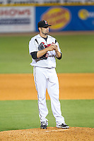 Nashville Sounds relief pitcher Rob Wooten (49) rubs up the baseball during the game against the Oklahoma City RedHawks at Greer Stadium on July 25, 2014 in Nashville, Tennessee.  The Sounds defeated the RedHawks 2-0.  (Brian Westerholt/Four Seam Images)