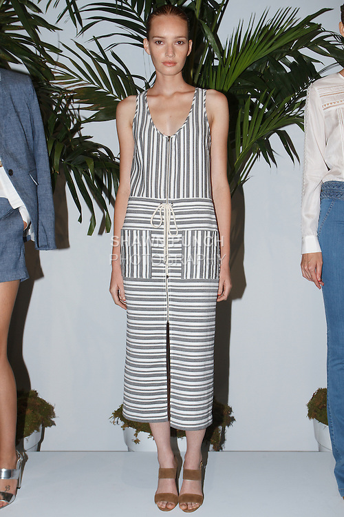 """Model poses in an outfit from the Veronica Beard Spring 2016 """"I Want It All"""" collection, during New York Fashion Week Spring 2016."""