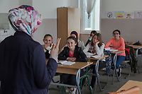 Serbia. Veliki Trnovac (in Albanian: Tërnoc i Madh) is a town in the municipality of Bujanovac, located in the Pčinja District of southern Serbia. «Muharrem Kadriu» Elementary School. The school's students are all from Albanian ethnicity. Classroom. 7th Grade. A teacher talks to her students during a religion class. The schoolteacher wears a hijab while her pupils are dressed according to the western dress code. A hijab is a veil worn by some Muslim women in the presence of any male outside of their immediate family, which usually covers the head and chest. Bujanovac is located in the geographical area known as Preševo Valley. The Pestalozzi Children's Foundation (Stiftung Kinderdorf Pestalozzi) is advocating access to high quality education for underprivileged children. It supports in Bujanovac a project called» Our towns, our schools». 16.4.2018 © 2018 Didier Ruef for the Pestalozzi Children's Foundation
