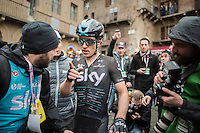 race winner Michal Kwiatkowski (POL/SKY) checking with carer Marko Dzalo about where he needs to go now...<br /> <br /> 11th Strade Bianche 2017