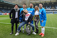 Matt Lapinskas, Warren Phillips and Stevi Ritchie pose for a photo with STORM Watch sponsors during the Celebrity football match in aid of the charity's 'Keep Moving Forward' programme which benefits people with mental health issues put together by Wycombe Wanderers Sports & Education Trust and Sellebrity Soccer Football Match at Adams Park, High Wycombe, England on 7 April 2019. Photo by David Horn.