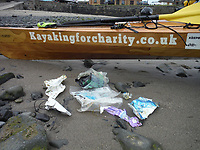 BNPS.co.uk (01202) 558833. <br /> Video: RoyBeal/KayakingForCharity/BNPS<br /> <br /> With Video - Download: https://we.tl/t-oBNxF4nwZe<br /> <br /> Pictured: Plastics collected from the water on trip. <br /> <br /> Potty paddler Roy Beal has written himself into the record books by kayaking from John O'Groats to Land's End – through canals, rivers and the sea.<br /> <br /> Roy embarked on the 900 mile odyssey that lasted 56 days in his wooden kayak named 'Just Add Water' and averaged around 20 miles a day.<br /> <br /> He paddled down the north east coast of Scotland, through Loch Ness and Loch Oich, down the west coast of Scotland and England to Merseyside where he ventured inland through canals and rivers before coming out through the Severn Estuary at Bristol and then around the south west coast to Land's End.