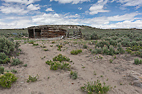 A shed built of railroad ties is at the end of a barely discernible trail, tracks left by wheels - truck, car, maybe horse drawn wagon.  Cobre, Nevada.