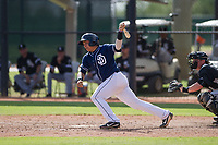 San Diego Padres catcher Juan Fernandez (55) follows through on his swing during an Instructional League game against the Chicago White Sox on September 26, 2017 at Camelback Ranch in Glendale, Arizona. (Zachary Lucy/Four Seam Images)