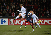 Lorient, France. - Sunday, February 8, 2015:  Carli Lloyd (10) of the USWNT and Jessica Houara D'Hommeaux (8) of France. France defeated the USWNT 2-0 during an international friendly at the Stade du Moustoir.