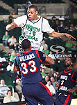 North Texas Mean Green guard Tristan Thompson (14) charges into South Alabama Jaguars guard Tim Williams (33) during the NCAA  basketball game between the South Alabama Jaguars and the University of North Texas Mean Green at the North Texas Coliseum,the Super Pit, in Denton, Texas. UNT defeated South Alabama 82 to 79...