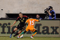 Mexico defender Jorge Torres Nilo (20) is marked by Ivory Coast defender Brice Dja Djedje (15). Mexico defeated the Ivory Coast 4-1 during an international friendly at MetLife Stadium in East Rutherford, NJ, on August 14, 2013.
