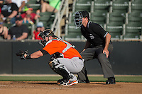 Augusta GreenJackets catcher Matt Winn (16) sets a target as home plate umpire Tom West looks on during the game against the Kannapolis Intimidators at Intimidators Stadium on May 30, 2016 in Kannapolis, North Carolina.  The GreenJackets defeated the Intimidators 5-3.  (Brian Westerholt/Four Seam Images)
