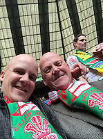 COPY BY TOM BEDFORD MEDIA<br /> Pictured: Matt Evans (L) watching Wales play South Africa in the Rugby World Cup at Twickenham.<br /> Re: Former postman, lotto Millionaire Matt Evans, 35, from Barry, south Wales, who has been spending his winnings to travel the world to watch various sports events.