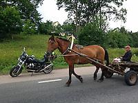 Medumi, Latvia, 19/07/2013.<br /> Moto Guzzi Bellagio and horse-drawn cart on E262.