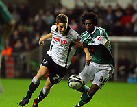 ATTENTION SPORTS PICTURE DESK<br /> Pictured: Joe Allen of Swansea (L) challenged by Yoann Folly (R) of Plymouth Argyle<br /> Re: Coca Cola Championship, Swansea City Football Club v Plymouth Argyle at the Liberty Stadium, Swansea, south Wales. Tuesday 08 December 2009