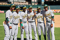 Oakland Athletics George Bell (6), Yerdel Vargas (20), Lazaro Armenteros (23), Christopher Quintin (13), Marcos Brito (2) and Kevin Richards (38) have their photo taken before an Instructional League game against the Arizona Diamondbacks on October 15, 2016 at Chase Field in Phoenix, Arizona.  (Mike Janes/Four Seam Images)