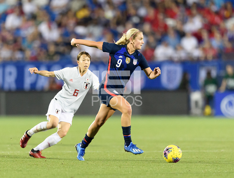 FRISCO, TX - MARCH 11: Lindsey Horan #9 of the United States brings the ball up the field against Japan during a game between Japan and USWNT at Toyota Stadium on March 11, 2020 in Frisco, Texas.