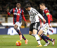Calcio, Serie A:  Bologna vs Juventus. Bologna, stadio Renato Dall'Ara, 19 febbraio 2016. <br /> Juventus' Alvaro Morata, center, is challenged by Bologna's Ibrahima MBaye, left and Daniele Gastaldello during the Italian Serie A football match between Bologna and Juventus at Bologna's Renato Dall'Ara stadium, 19 February 2016.<br /> UPDATE IMAGES PRESS/Isabella Bonotto