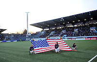 Lorient, France. - Sunday, February 8, 2015: US Flag during pre-game intro. USWNT vs France during an international friendly at the Stade du Moustoir.