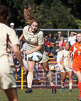 Boston College midfielder Patrice Vettori (18) heads the ball. .After two overtime periods, Boston College (gold) tied University of Miami (orange), 0-0, at Newton Campus Field, October 21, 2012.