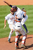 Catcher John Hicks #8 of the Virginia Cavaliers lifts pitcher Tyler Wilson #18 into the air as Steven Proscia #19 comes running to join the celebration as the Virginia Cavaliers defeated the Florida State Seminoles 7-2 to win the Championship Game of the 2011 ACC Baseball Tournament at the Durham Bulls Athletic Park on May 29, 2011 in Durham, North Carolina.  Photo by Brian Westerholt / Four Seam Images