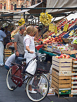 Woman shopping for food at market in Piazza delle Erbe, Padua Ital
