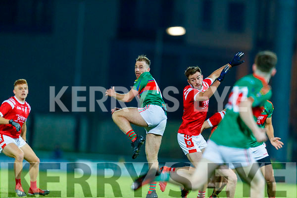 David Roche, Mid Kerry in action against Brendan O'Keeffe, East Kerry during the Kerry County Senior Football Championship Final match between East Kerry and Mid Kerry at Austin Stack Park in Tralee on Saturday night.