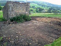 BNPS.co.uk (01202 558833)<br /> Pic: BNPS<br /> <br /> The land before the eco-friendly retreat was built<br /> <br /> A resourceful couple have made a £150,000 profit after knocking down a derelict old farm building and constructing an impressive eco-friendly retreat in its place.<br /> <br /> Art technician Danielle Coates, 33, and her husband Ben, 33, a carpenter, have created The Rookery, in the scenic village of Roughlee, East Lancs.<br /> <br /> They spent £200,000 buying six acres of farmland and building the two bedroom detached stone home. It has been a shrewd investment as the property, which was completed in 2015, is now valued at £350,000.<br /> <br /> They are currently renting out the two bedroom cottage as a holiday let on cottages.com, with it generating an annual turnover of £50,000.<br /> <br /> Original stones from the demolished farm building have been incorporated into the new structure. Solar panels have been fitted to generate enough energy to run the entire house, and recycled timber from the farm used to fashion shelves and handles.