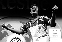 Pix: Michael Steele/SWpix.com. Embassy World Darts. Frimley Green, Essex. 1992...COPYWRIGHT PICTURE>>SIMON WILKINSON>>01943 436649>>..Darts legend Eric Bristow celebrtaes another World title.