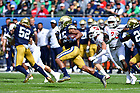 September 25, 2021; Running back Chris Tyree (25) returns a kickoff for a touchdown against Wisconsin during the Shamrock Series game at Soldier Field in Chicago. (photo by Matt Cashore)