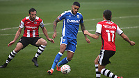 Dominic Samuel of Gillingham in possession as Rory McArdle and Randell Williams of Exeter City look on during Gillingham vs Exeter City, Emirates FA Cup Football at the MEMS Priestfield Stadium on 28th November 2020