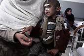Kabul, Afghanistan<br /> November, 2001<br /> <br /> Indira Ghandi children's hospital - Malnutition Ward funded by Save the Children.<br /> <br /> Six year old Shukrallah who is suffering from severe malnutrition with his mother Zainab from Tagabnejrab, south of Kabul.