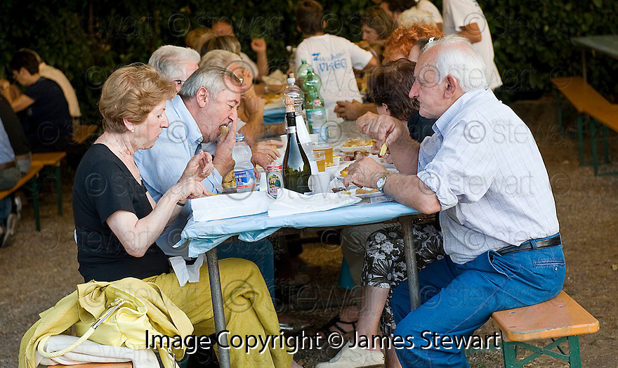 "SAGRA DEL ""PESCE E PATATE"" 2011, BARGA, ITALY<br /> <br /> THE VISITORS ENJOY THEIR FISH AND CHIPS."