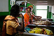 Relatives of the new born babies share a light moment in pediatrics ward of Duncan Hospital in Raxaul of East Champaran district of Bihar, India. Since 2008 the Foundation and Geneva Global have been investing in the training of medical staff to improve the lives of people living in 600+ villages in the region. The NGOs are delivering cost effective interventions to address treatment, care and prevention of diseases, disability and preventable deaths amongst infants, adolescent girls and women of child-bearing age. There is statistical and anecdotal evidence that there have been vast improvements and a total of 40-50% increased immunization for all children under 6 has meant that communities can be serviced and educated long term. Photograph: Sanjit Das/Panos for Legatum Foundation