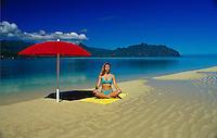 Woman meditating at Ahu O Laka, Kaneohe sand bar, Oahu