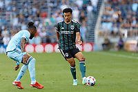 ST PAUL, MN - AUGUST 14: Niko Hamalainen #15 of the Los Angeles Galaxy dribbles the ball during a game between Los Angeles Galaxy and Minnesota United FC at Allianz Field on August 14, 2021 in St Paul, Minnesota.