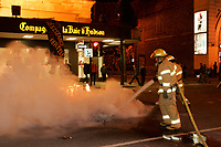 Nov 5, 2005, Montreal (QC) CANADA<br /> <br /> Montreal city firemen extinguish a sofa set ablaze by protesters in downtown Montreal.<br /> Photo : (c) 2006 Pierre Roussel