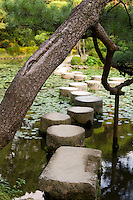 Myriad paths with scarcely a traveler<br /> Yesterday's wanderings seem like a dream<br /> -Ryokan<br /> <br /> A trained pine bends over the stepping stones that make up the famous Garyukyo Bridge at Kyoto's Heian Shrine, Japan.<br /> <br /> (title translation Ryuichi Abe & Peter Haskel)