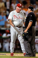 3 September 2005: Charlie Manuel, Manager of the Philadelphia Phillies, discusses a call with home plate umpire Ed Montague during a game against the Washington Nationals. The Nationals defeated the Phillies 5-4 at RFK Stadium in Washington, DC. <br />