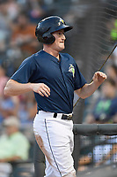 Left fielder Ian Strom (40) of the Columbia Fireflies is greeted after scoring a run in a game against the Charleston RiverDogs on Monday, August 7, 2017, at Spirit Communications Park in Columbia, South Carolina. Columbia won, 6-4. (Tom Priddy/Four Seam Images)